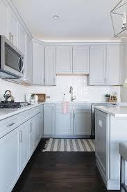 turkish fringe rug with gray cabinets
