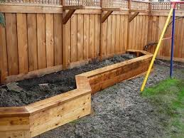 Raised Planter Box Along Fence That Doubles As A Bench Also Brackets For Hanging Plants Or Solar Lights Jeanett Raised Planter Boxes Raised Planter Backyard