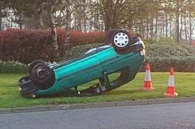 Police officers discover stolen car on its roof in Tower View, Kings Hill,  but have been unable to find the driver