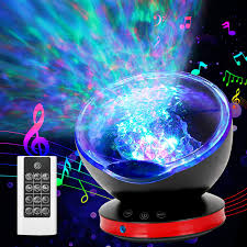 Amazon Com New Version Ocean Wave Projector 12 Led Remote Control Undersea Projector Lamp 8 Color Changing Music Player Led Night Light Projector For Kids Adult Bedroom Living Room Decoration Black Home Improvement
