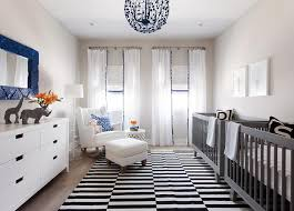 blue and gray twins nursery design with