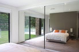 consider a mirrored closet door to add