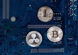 Virtual symbols of the coin Bitcoin, Litecoin and Ripple | Flickr
