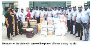 group showers gifts on prison inmates
