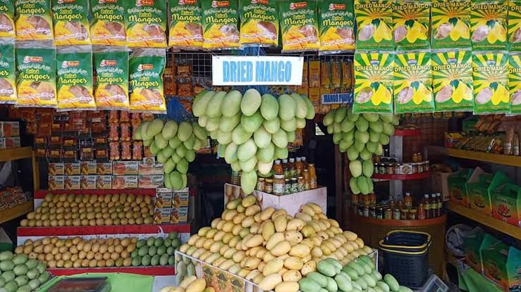 Image result for mangoes in stand""