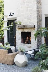 patio with gray stone fireplace