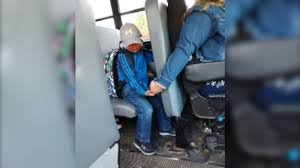 Bus driver holds nervous boy's hand on first day of school - ABC7 Chicago