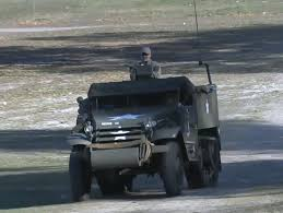 this red wwii half track is a
