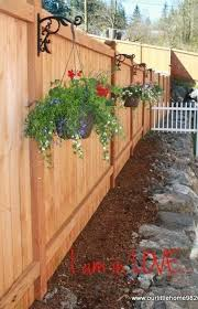 Hang Flower Pots On A Fence Fence Buildfence Gardenfence Gardenfenceideas Privacyfenceideas Privacy Fence Landscaping Backyard Fences Fence Landscaping