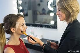doing makeup to beautiful young