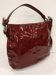 ashley burdy patent leather hobo