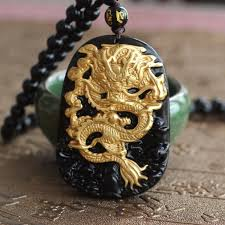 hand carved 18k gold dragon pendant