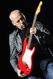 Let it be heard: Mark Knopfler makes his guitar do the singing | Star  Tribune