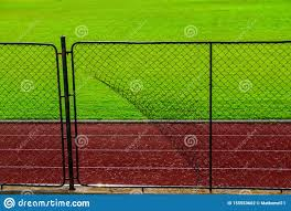Broken Iron Wire Fence And Athletic Race Track Stock Photo Image Of Enclose Fortify 155553662