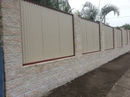 Elegant White Cement Block Fence Wall That Decorated With White Iron Materials Inside Make It Seems Elegant Modern Fence Design Fence Design Fence Wall Design