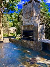 outdoor stone fireplace with a braai