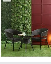 wicker chairs and table garden