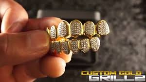 paul wall custom gold grillz here s