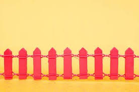 Small Red Wooden Picket Fence On Bright Yellow Background Stock Photo Picture And Royalty Free Image Image 44691525