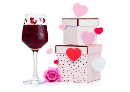 red wine with heart and pink gift box