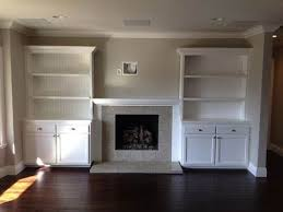 shelving around fireplace you