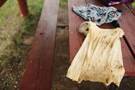 dirty clothes on a wooden table stock