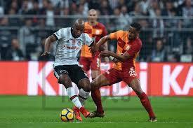 Soccrates Images - (L-R) Ryan Babel of Besiktas, Fernando of Galatasaray