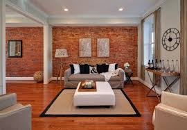 hang picture frames on a brick wall