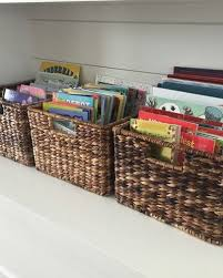 Organize Kids Books In Baskets On A Shelf To Keep The Play Room Neat And Organized Teach Your Childr Organizing Kids Books Kids Book Storage Organization Kids