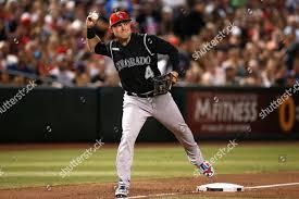 Colorado Rockies third baseman Pat Valaika throws Foto editorial ...