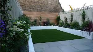 Sawn Grey Sandstone Paving Raised Rendered Beds Hardwood Screen Painted Stone Fence London Small Garden Design Archives London Garden Blog