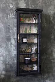 slim distressed black wall cabinet