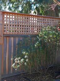 Diy Privacy Fence Trellis Added To The Top Of The Fence Panels To Add Height And Privacy Privacy Fence Designs Fence Design Cheap Privacy Fence