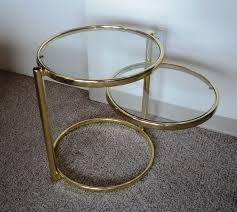 pivoting brass glass side table