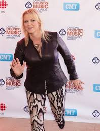 Country recording artist Carolyn Dawn Johnson, nominee for female artist of  the year, poses for a