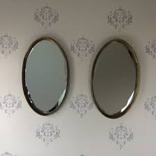oval gold hollywood regency mirrors