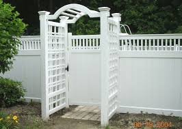 Vinyl Arbor With English Square Lattice By Elyria Fence Vinyl Fence Backyard Fences Vinyl Privacy Fence