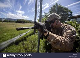 U.S. Marine Corps Sgt. Wesley Bowman, squad leader with Marine Rotational  Force Darwin 2018, provides security during exercise Croix Du Sud at  Koumac, New Caledonia, May, 22, 2018. The exercise, hosted by