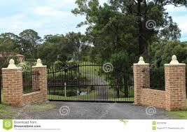 Black Wrought Iron Entrance Gates Set In Brick Fence Stock Photo Image Of Fence Black 52224206