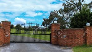 Metal Driveway Entrance Gates Set In Brick Fence Stock Photo Picture And Royalty Free Image Image 40087157