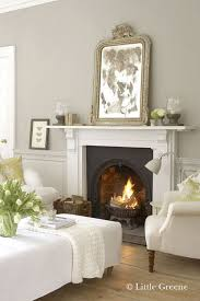 white fireplace and mirror leaning