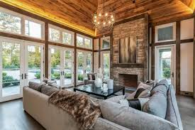 ceiling and stone veneer fireplace