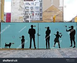 People Drawing Silhouette On Fence Securing The Arts Stock Image 1124103533