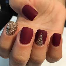 picture of matte burgundy nails with a