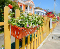 Hanging Flower Pots With Fence Stock Photo Picture And Royalty Free Image Image 28796802