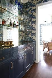 bar cabinets with mirrored backsplash