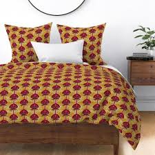 african inspired print flower gold