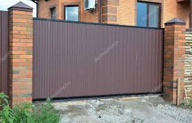 Pictures Brick Fence Ideas Brick And Metal Fence With Metal Gate Of Modern Style Design Decorative Cracked Brick Wall Surface Exterior Steel Fence Gate House Design Ideas Stock Photo C Thefutureis 123204032