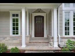 wooden front doors with glass side