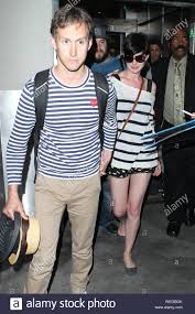 Los Angeles, CA - Anne Hathaway and her husband Adam Shulman are greeted by  a massive swarm